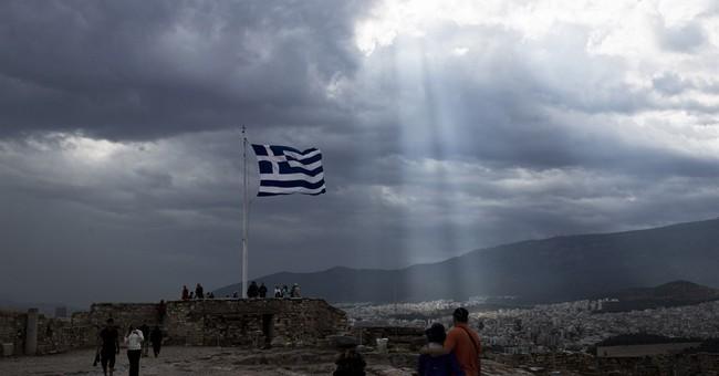AP PHOTOS: Greece's odyssey through its latest crisis