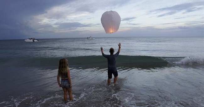 The Latest: Coast Guard: Search for missing boaters ongoing