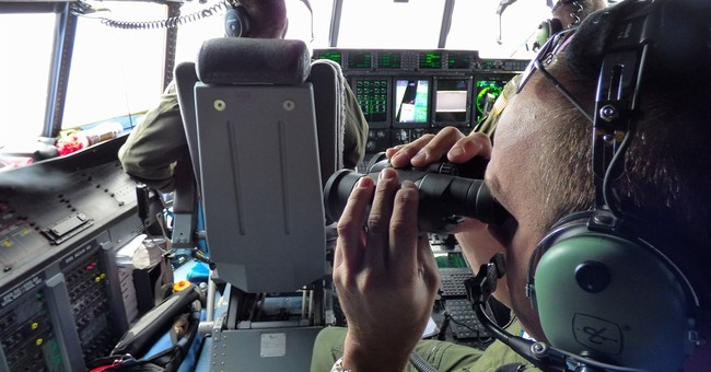 The Latest: Pilot calls search for adrift boys heartbreaking