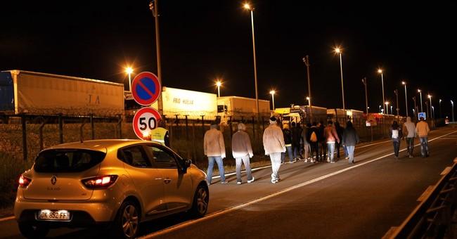 France deploys riot police to bolster Calais security