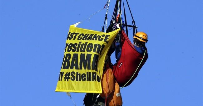 Activists rappel off Oregon bridge to stop Shell icebreaker