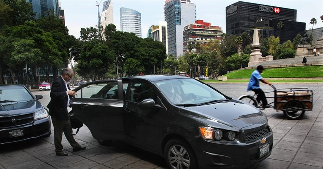 Uber cars bashed in Mexico, cabbies protest rideshare apps