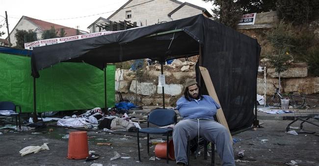 Israeli bulldozers start demolishing West Bank settlement