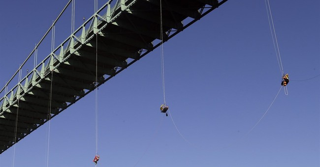 Activists rappel off Oregon bridge to stop Shell icebreaker