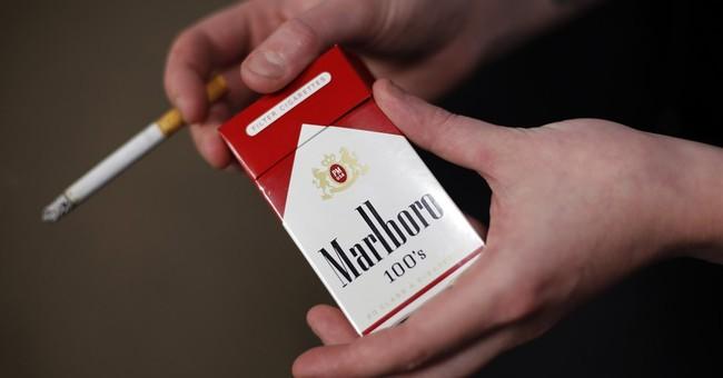 Better economy has smokers buying more Marlboros