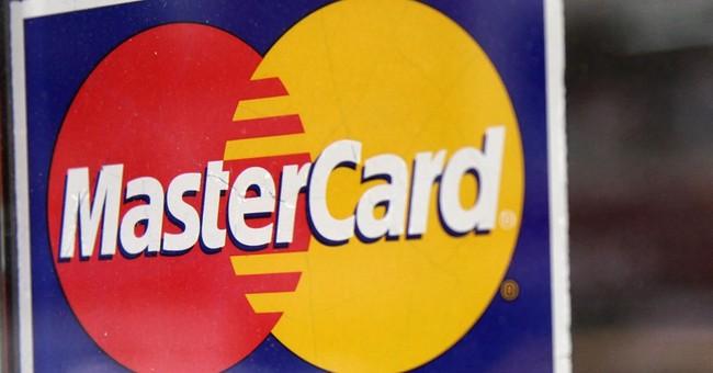MasterCard 2Q profit slips and revenue falls short