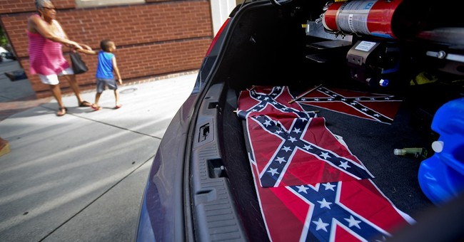 Some Americans refuse to give up on Confederate flag