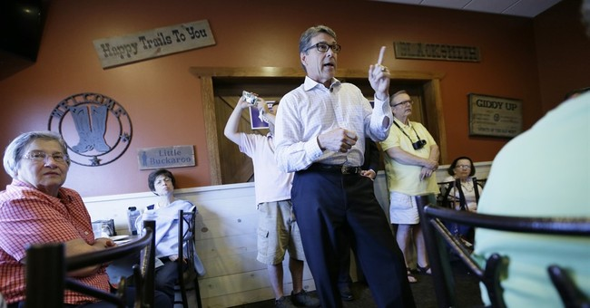 Perry dials back Christian appeal in Iowa, cites job record