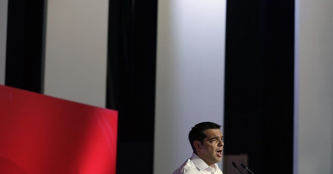 Greece's Tsipras prevails over rebels at party meeting