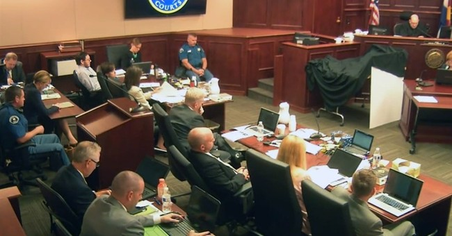 The Latest: Colorado shooting judge holds woman in contempt