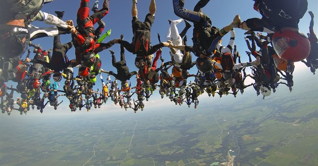 164 skydivers smash head-down world record in Illinois