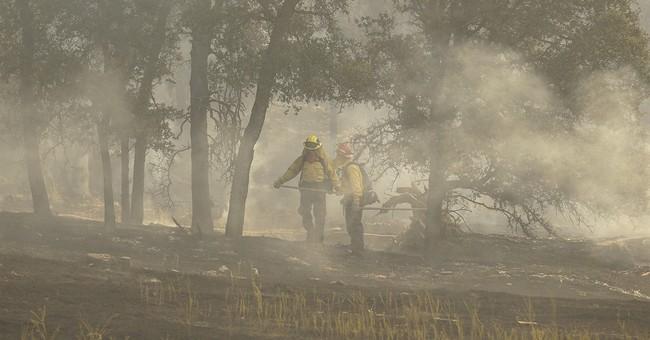 Firefighter killed, 2 dozen homes burn in California fires