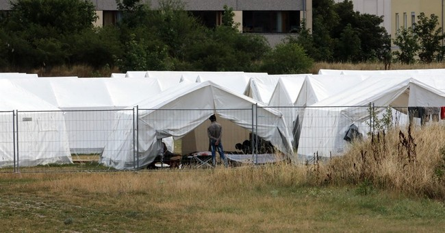 Austrian government to end migrant standoff with provinces