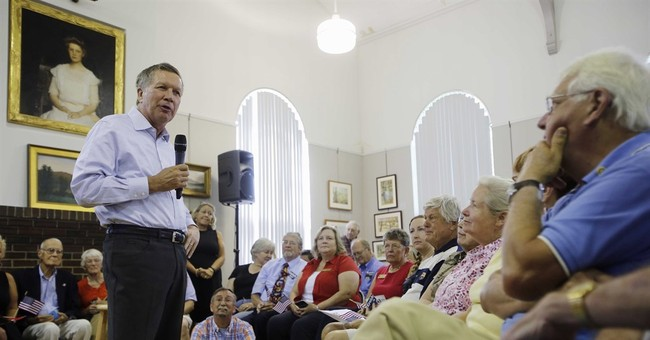 Seeking pre-debate boost, Kasich zeroes in on New Hampshire