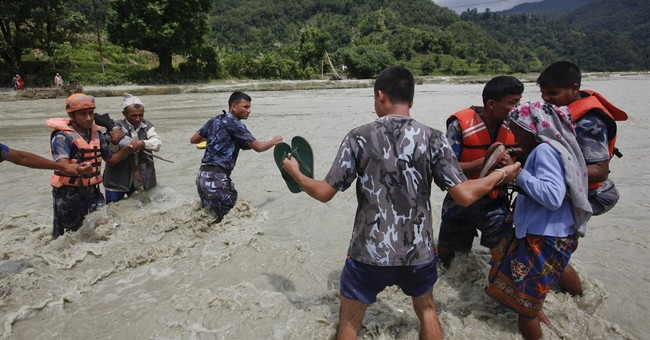 Image of Asia: Crossing the river after monsoon flooding