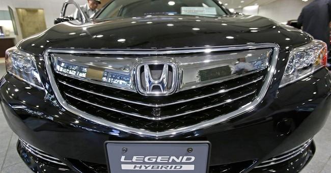 Honda records 20 pct profit rise on yen, despite recalls