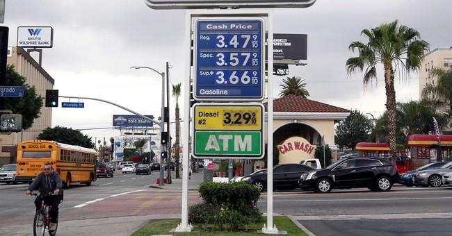 Exxon profit falls by half but production rises
