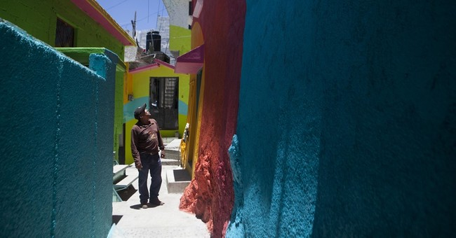 Working-class barrio turns into huge rainbow mural in Mexico