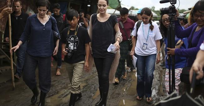 Jolie, Suu Kyi visit Myanmar female factory workers
