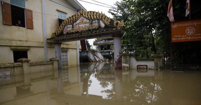 Myanmar's president visits area worst-hit by flooding