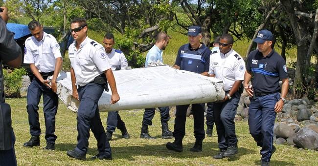 Investigators for missing Malaysia flight meet in Paris