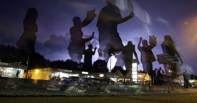 Ferguson spurs 40 new state measures; activists want more