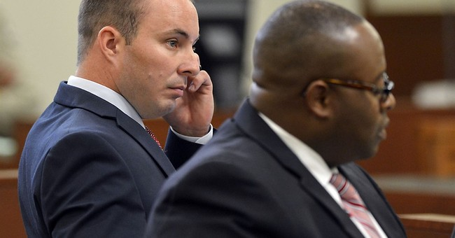 Crime-scene photos cited in police officer's trial