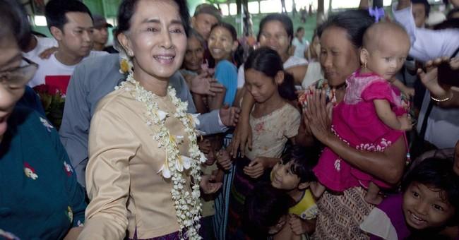 Myanmar opposition leader Suu Kyi visits flood-hit area