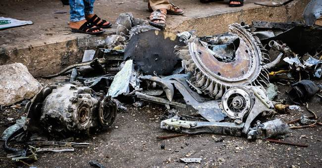 Syrian air raids, warplane crash kill at least 27 people