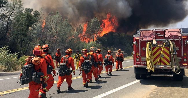 The Latest: Calif. wildfire grows after jumping containment