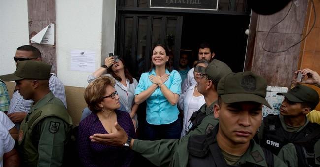 Venezuela first lady runs for congress; spouse's foe blocked
