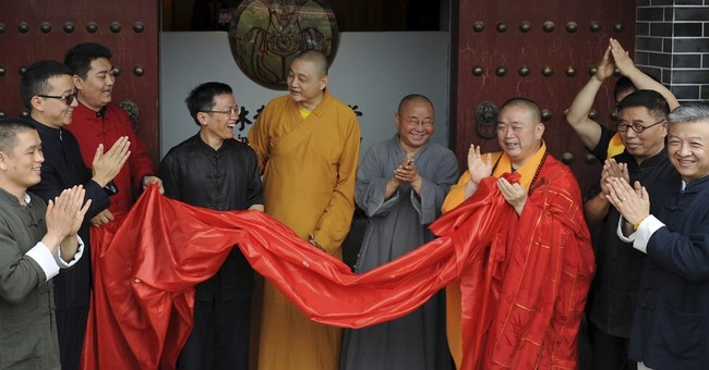 China bureau probing controversial Shaolin Temple abbot