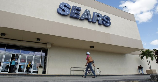 Sears sales fall sharply in 2Q as it spins off real estate