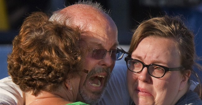 The Latest: Theater shooting victim's mom: 'I cry every day'