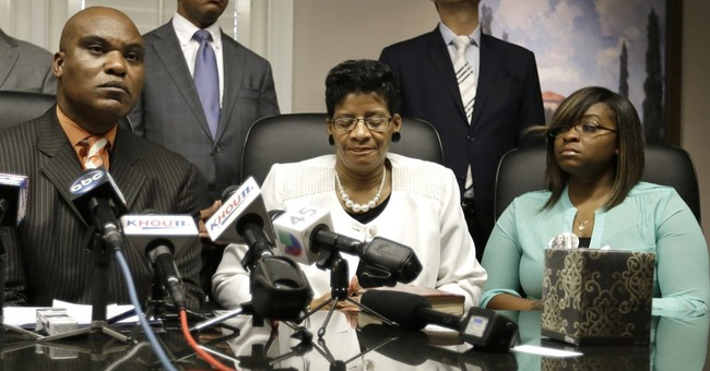 Sandra Bland's family sues state trooper, wants answers