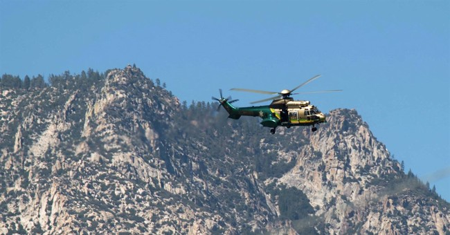 Manhunt focuses on rugged area of California after attacks