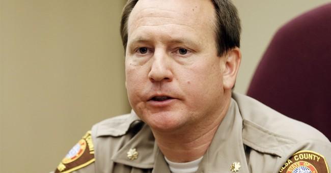 Ex-Tulsa sheriff's spokesman says he was wrongfully fired