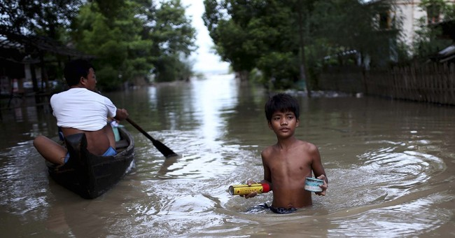 Myanmar floods move downriver, risking more populated areas