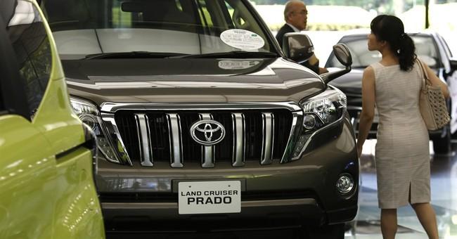 Toyota's quarterly profit up 10 pct on cheap yen, cost cuts