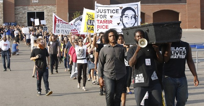 Protesters mark year since fatal police shooting in Wal-Mart