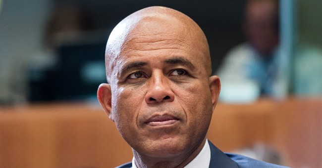 Officials exit Haiti gov't over president's remarks to woman