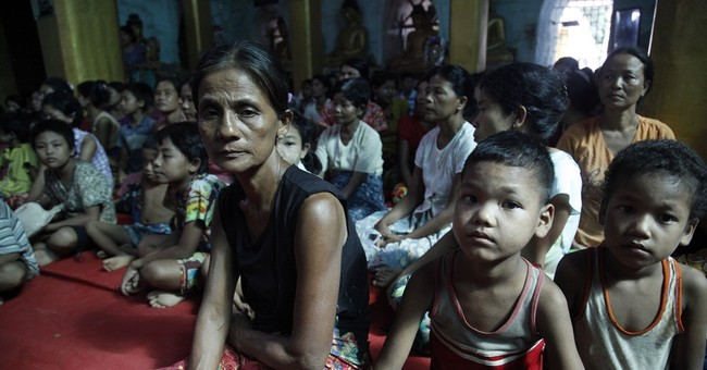 Aid flowing, but Myanmar at risk of more flooding