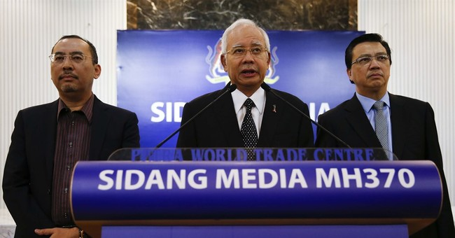 News Guide: Malaysia links debris to MH370; others cautious