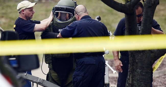 Man wielding pellet gun, ax attacks theater; shot by police