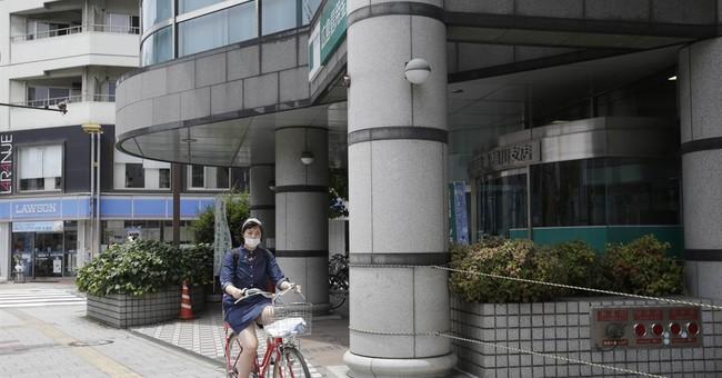 AP PHOTOS: Hiroshima after the atomic bomb _ and today