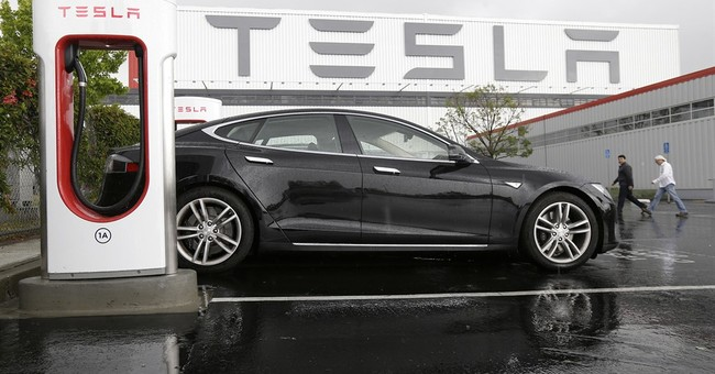 Tesla's loss triples in 2Q as it lowers delivery forecast