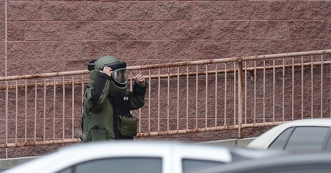 The Latest: Officer in theater attack thought he'd been shot