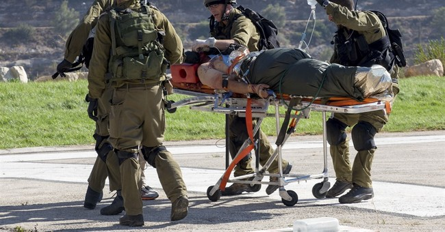 Palestinian rams car into Israeli soldiers, wounding 3