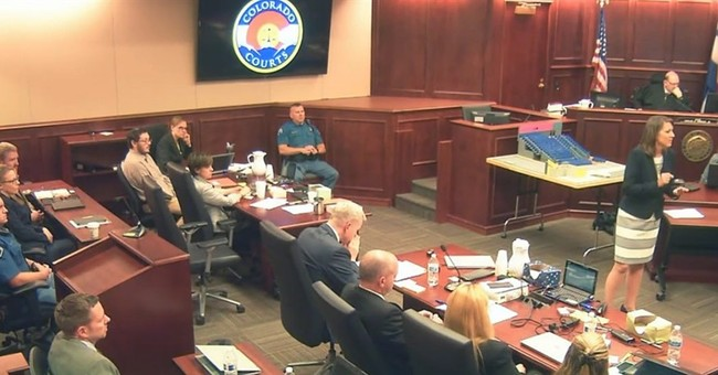 The Latest: Theater shooting deliberations resume Friday