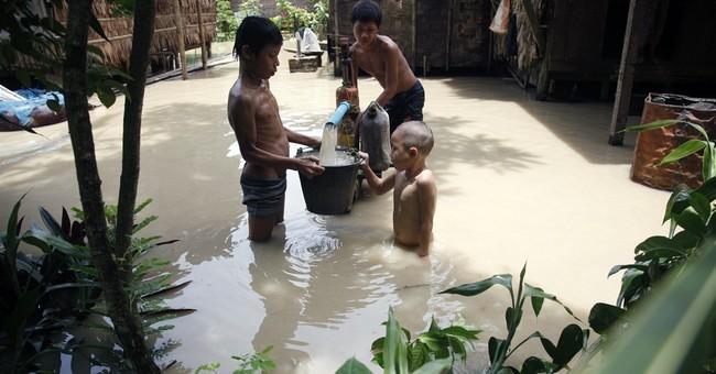 Myanmar's Suu Kyi warns against flood-linked vote tampering